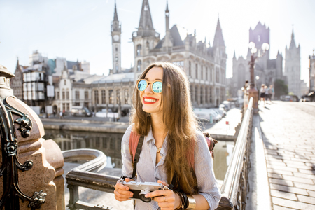 former: Woman traveling in Gent old town, Belgium