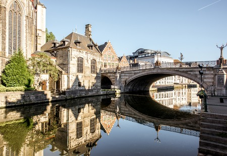 Morning view on the saint Nicholas bridge and church in Gent city, Belgium