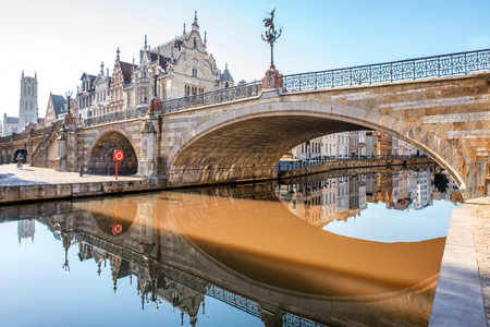 Morning view on the old town with beautiful reflection in the water channel in Gent city, Belgium
