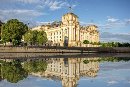 Morning cityscape view on the famous Reichstag building with beautiful reflection in the water in Berlin city Reklamní fotografie