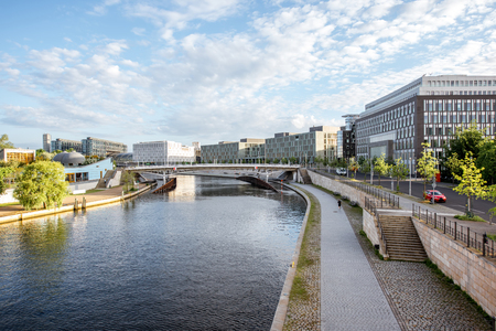 Morning cityscape view on the modern financial district with Spree river near the parliament building in Berlin city