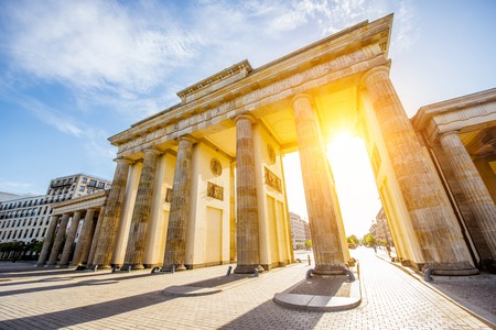 View on the famous Brandenburg gates on the Pariser square during the sunrise in Berlin city