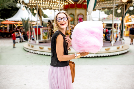 turnabout: Woman with cotton candy at the amusement park