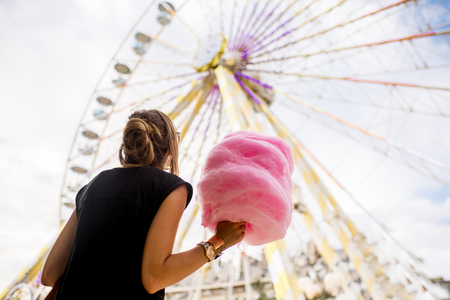 Woman with cotton candy at the amusement park