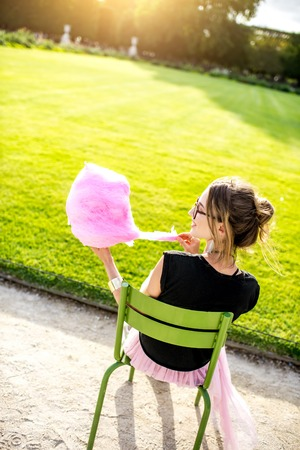 Woman with cotton candy at the park