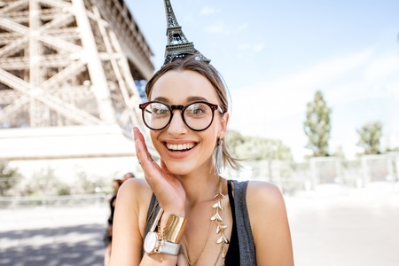 Woman with toy Eiffel tower