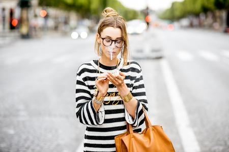 Woman smoking on the street Stock Photo