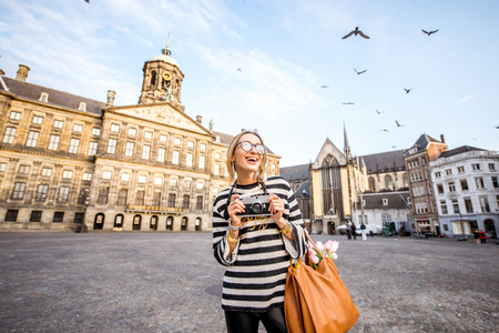 Woman traveling in Amsterdam city 스톡 콘텐츠