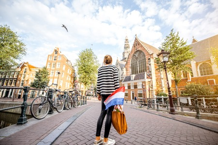 Woman traveling in Amsterdam city 版權商用圖片
