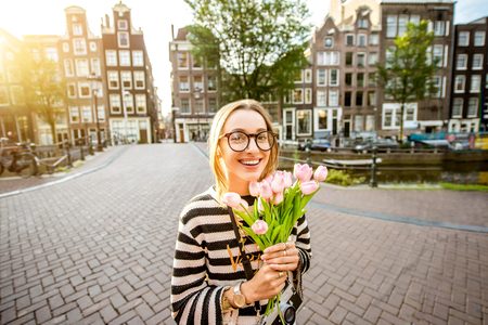 Woman with tulips in Amsterdam city
