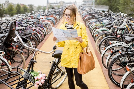 Woman on the bicycle parking in Amsterdam