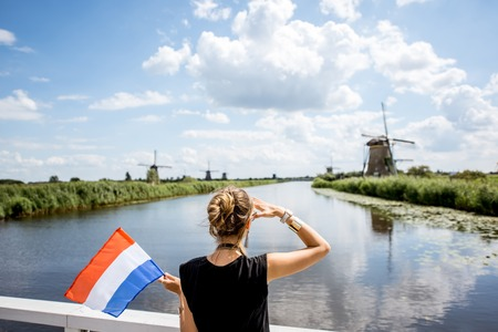 Woman near the old windmills in Netherlands Imagens