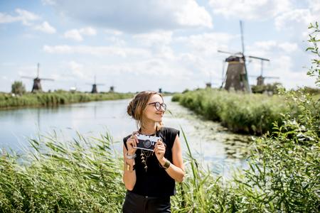 Woman near the old windmills in Netherlands Banco de Imagens