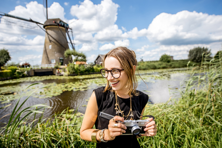 Woman near the old windmills in Netherlands Stock Photo