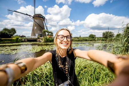 Woman near the old windmills in Netherlands Stok Fotoğraf - 85043132
