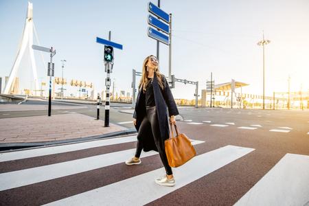 Woman walking the street in Rotterdam Banco de Imagens