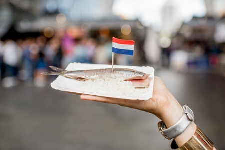 Holding herring with onions