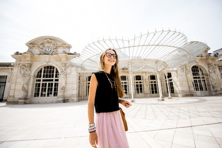 Woman near the old beautiful building in Vichy city, France Stock Photo - 85120278