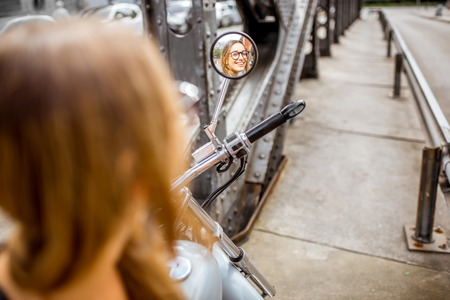 woman mirror: Woman on the motorcycle