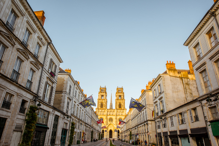 Street view with famous cathedral during the sunset in Orleans city in central France