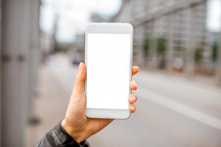 Holding smartphone on the bridge Imagens
