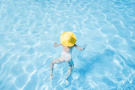 Woman swimming at the pool Stock Photo