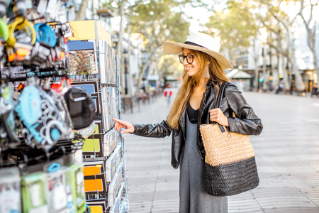 Young woman tourist choosing souvenirs on the central shopping street in Barcelona Stock Photo