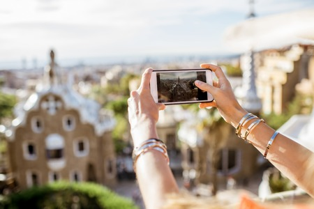 Photographing with phone Guell park in Barcelona city Reklamní fotografie