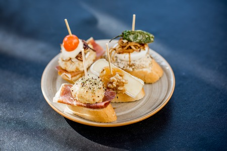Beautiful and colorful set of pinchos, traditional spanish snack related to tapas, outdoors on the table Stok Fotoğraf