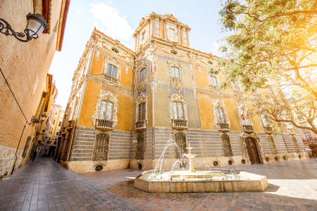 Street view with foutain and national museum of ceramics and decorative arts building in Valencia city, Spain