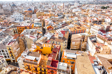 Top cityscape view on the old residential buildings in Valencia city during the sunny day in Spain