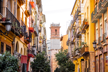 Street view with beautiful old buildings and saint Bartolomeu tower in Valencia, Spain
