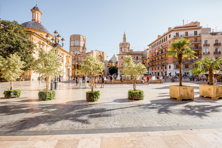 View in the Virgen square with cathedral in the centre of Valencia city during the sunny day in Spain