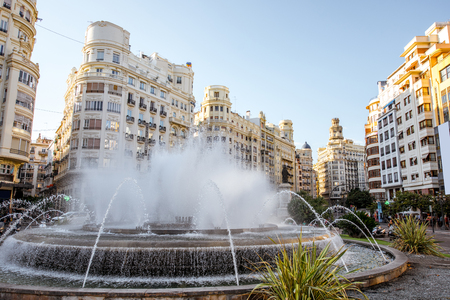 View on the Ayuntamiento square with fountain and beautiful buildings in Valencia city in Spain