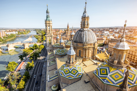 Aerial cityscape view on the roofs and spires of basilica of Our Lady in Zaragoza city in Spain