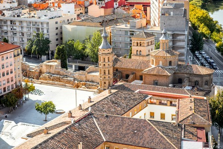 Top view on the old town with saint Juan basilica in Zaragoza city during the sunny day in Spain