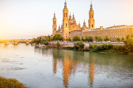 Landscape view on Elbe river with cathedral of Our Lady of the Pillar in Zaragoza city in Spain