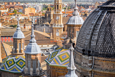 Aerial cityscape view on the roofs and spires with beautiful tiles of basilica of Our Lady in Zaragoza city in Spain