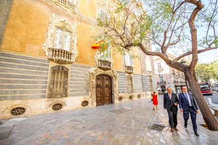 VALENCIA, SPAIN - August 18, 2017: View on the national museum of ceramics and decorative arts with business people walking in Valencia city, Spain