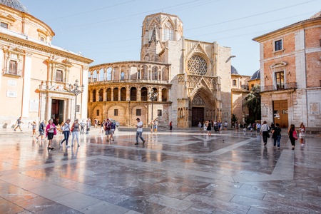 VALENCIA, SPAIN - August 18, 2017: View on the Virgen square crowded with people and cathedral of the Assumption of Our Lady in Valencia city, Spain