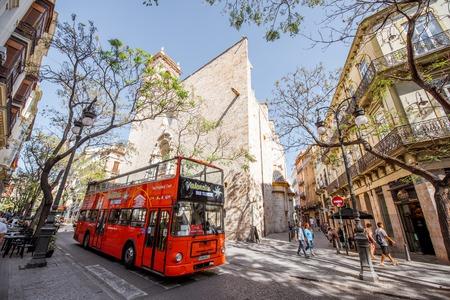 VALENCIA, SPAIN - August 18, 2017: Street viewwith saint Martin church and touristic bus in Valencia old town, Spain