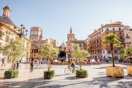 VALENCIA, SPAIN - August 18, 2017: View on the Virgen square with cathedral of the Assumption of Our Lady crowded with people in Valencia city, Spain