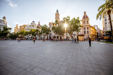 VALENCIA, SPAIN - August 18, 2017: View on the Ayuntamiento square with city hall building during the sunset in Valencia city in Spain