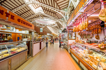 VALENCIA, SPAIN - August 19, 2017: Interior of the central food market located in across from the Llotja de la Seda and the church of the Juanes in Valencia city