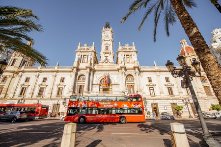 VALENCIA, SPAIN - August 19, 2017: View on the city hall building with tourist bus during the morning light in Valencia city in Spain