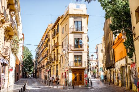 VALENCIA, SPAIN - August 19, 2017: Street view with beautiful old buildings in the old town of Valencia, Spain 新聞圖片