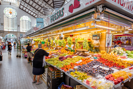 VALENCIA, SPAIN - August 19, 2017: Store with food at the central market located in across from the Llotja de la Seda and the church of the Juanes in Valencia city