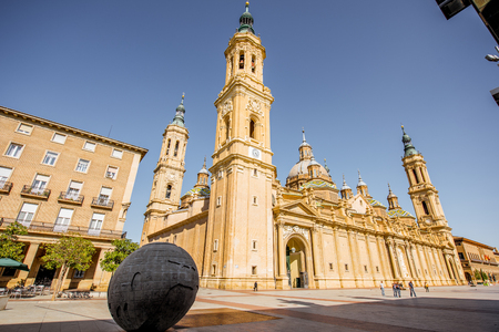 ZARAGOZA, SPAIN - August 20, 2017: View on the cathedral of Our Lady of the Pillar with Earth monument on the central square in Zaragoza city, Spain Editorial