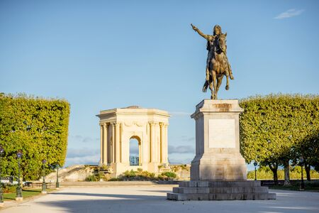 View on the beautiful Peyrou promenade with Louis statue and pavillon in Montpellier city during the morning light in southern France Stock fotó