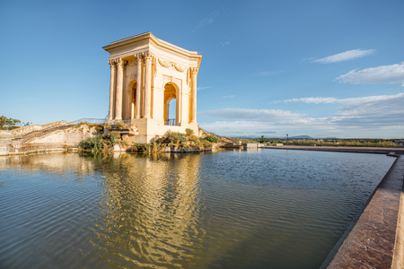 View on the water tower in Peyrou garden with beautiful water reflection during the morning light in Montpellier city in southern France